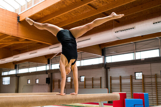 young artistic gymnast woman performing and training