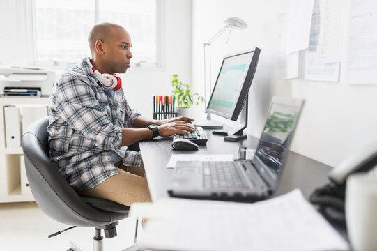 Black businessman working in office