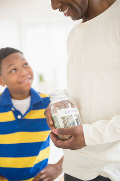 Father and son saving money for college