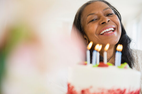 Mixed race woman celebrating birthday