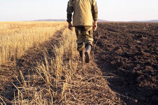 Mari farmer walking in crop fields