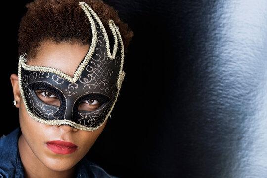 Mixed race woman wearing mask