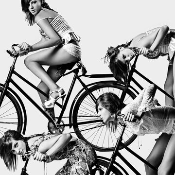 Multiple exposure of Caucasian girl riding bicycle