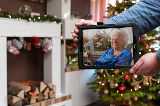 During the Corona Pandemic, the family does not get together at Christmas. The grandmother is online by the family via new media. Video call.