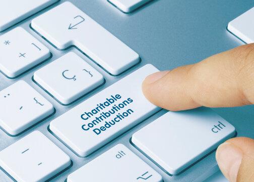 Charitable Contributions Deduction - Inscription on Blue Keyboard Key.