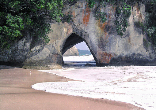 Secret Paradise Beach Cave. Location is a remote beach among lime stone rocks called Cathedral Cove in New Zeeland
