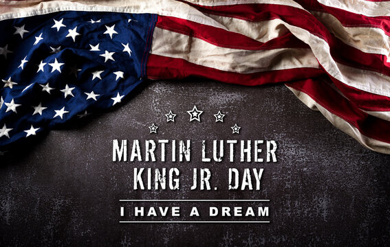 Happy Martin Luther King Day concept.  American flag againt dark stone background