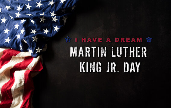 Happy Martin Luther King Day concept.  American flag againt black wooden background