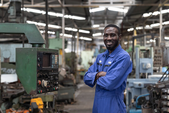 Portrait of smiling black male engineer at work in the industry factory.