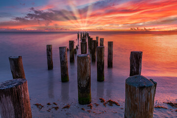 old and historic pier at sunset. Old harbour near naples pier america. Coastal dreams near naples bridge florida usa. Landscape and beauty of nature concept.