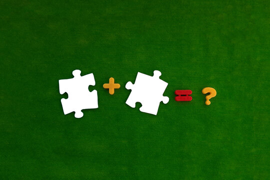 Two puzzle pieces are white, plus and question marks are yellow, and the equal sign is red on a green background. The concept of interaction, connection into a single whole.