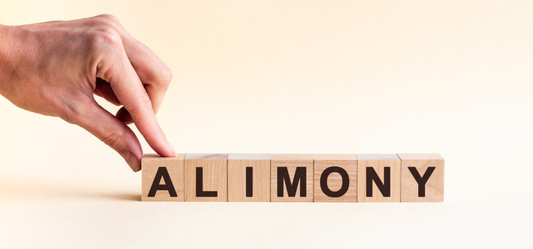woman made word alimony with wood blocks