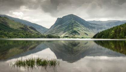 Tranquil view down Buttermere with reflected fells