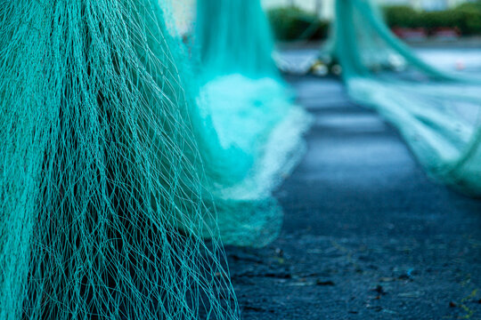Blue abstract fishing nets at the harbor