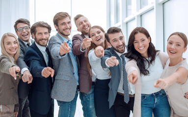 group of successful young people pointing at you