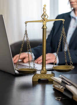 scales workplace lawyer office laptop document table type hand
