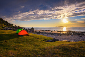 Wall Mural - Camping at sunset with tents on Uttakleiv beach in Lofoten islands, Norway