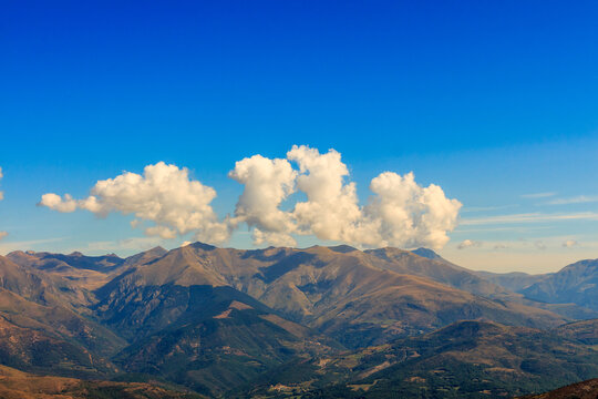 Clouds with curious elongated shapes on top of a mountain. Nature elements concept