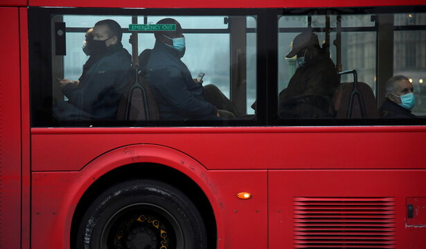 Passengers on a London bus wear face masks during the morning rush hour, amid the spread of the coronavirus disease (COVID-19), London, Britain