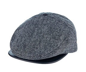Beautiful tweed cap made of grey wool with a leather visor isolated on a white background. Sample of men's style.