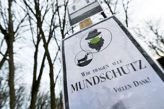 """A sign reading """"We all wear mouth protection"""" is seen at the entrance to a closed beer garden as the spread of the coronavirus (COVID-19) disease continues in Munich"""