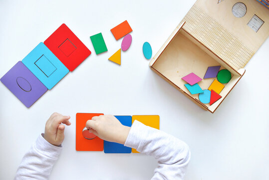Learning colors and shapes. Children's wooden toy. The child collects a sorter. Educational logic toys for kid's. Kindergarten educational toys, Cognitive skills, Learn Through Play tools concept