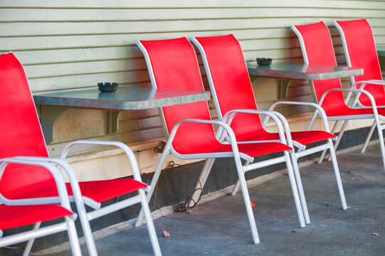 Red and White Chairs on sidewalk