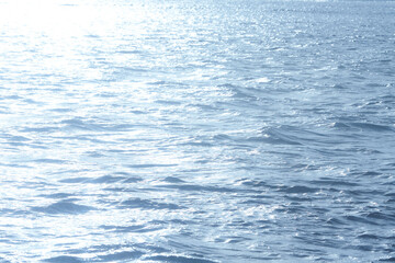Blue sunlight reflecting in glittering sea. sparkling in water