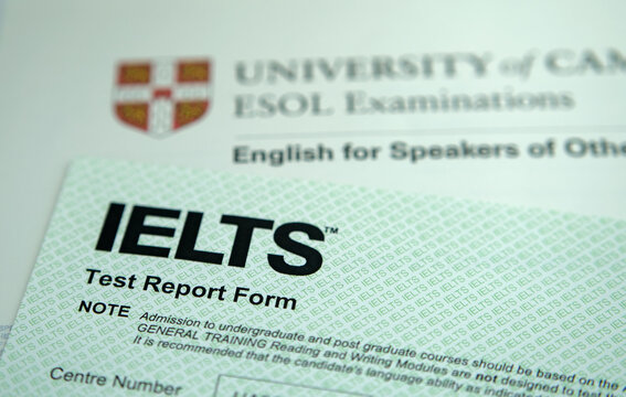 Authentic IELTS test report form with BEC certificon the background. IELTS is a test of language proficiency for non-native English language speakers. Stone / United Kingdom - February 2 2020: