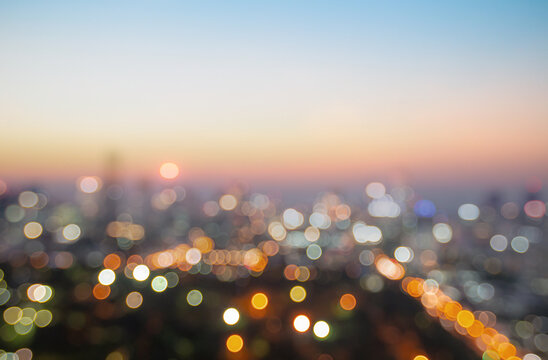 Bokeh light and blur city skyline sunrise background. Bangkok, Thailand, Asia