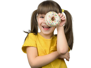 Photo of attractive little girl long straight ponytails holds in a hand a glazed white doughnut. Happy girl looking through the donut, wears in casual yellow shirt on isolated background