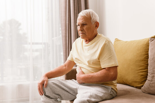 Senior man is suffering from problems with a digestion