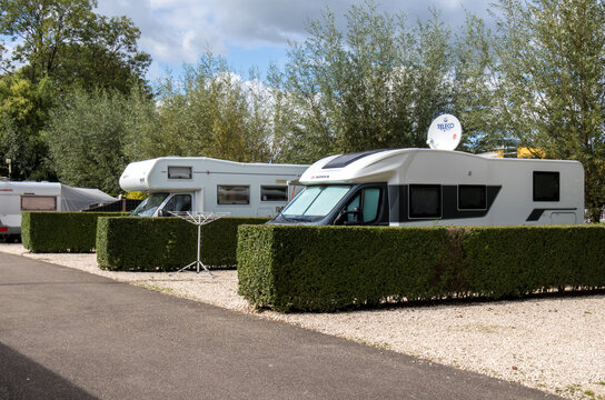Motorhome campers parked on hardstanding in a camping camp site