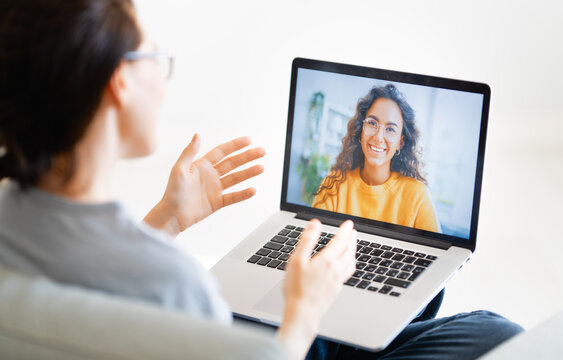 woman is using laptop for remote conversation
