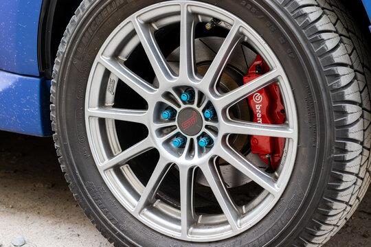 Stylish Subaru WRX STI car wheel with Michelin tire and red brake caliper. Brake system support by Brembo