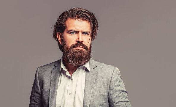 Portrait of handsome bearded man in suit. Male beard and mustache. Sexy male, brutal macho, hipster. Elegant handsome man in suit. Handsome bearded businessman