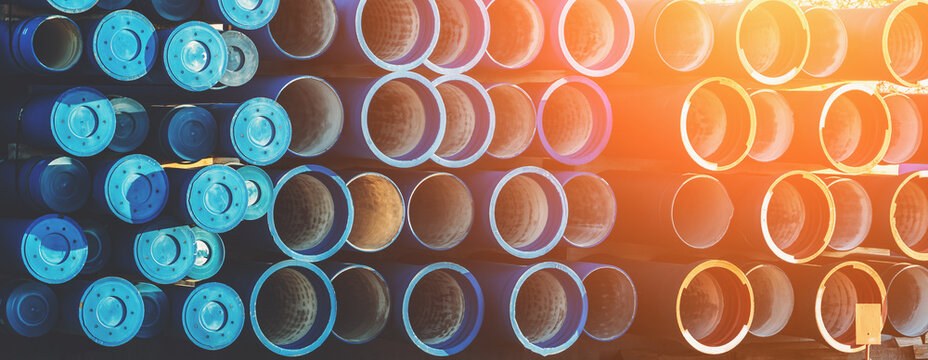Plastic pipe background, big PVC pipes in stack for water and drain or wastewater.