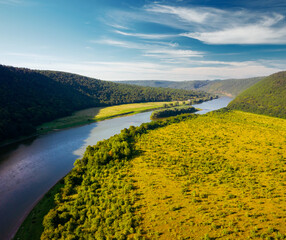 Wall Mural - Attractive view from a drone flying over the sinuous river.