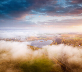 Wall Mural - Attractive top view of the misty valley in the morning. Aerial photography, drone shot.
