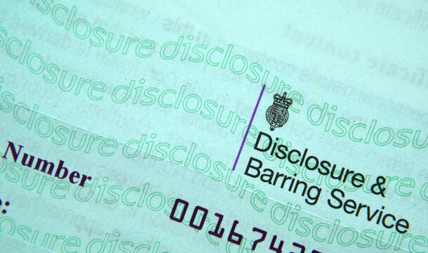 Stafford / UK - January 17 2020: Authentic Disclosure & Barring Service certificate. DBS check in the UK prevent unsuitable people from working with vulnerable groups, including children.