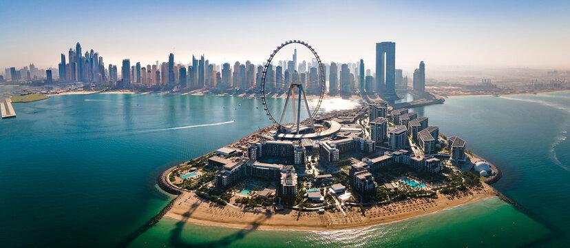 Ain Dubai ferris wheel on Bluewaters island with amazing Dubai skyline in the UAE
