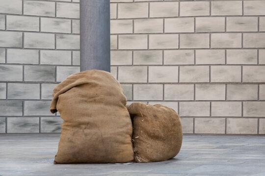 Brown jute bag with hay, debris or food