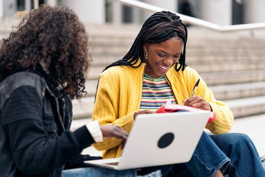 Cool Afro Girls Using Laptop
