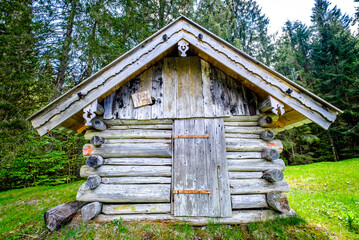 Wall Mural - old wooden hut at the alps
