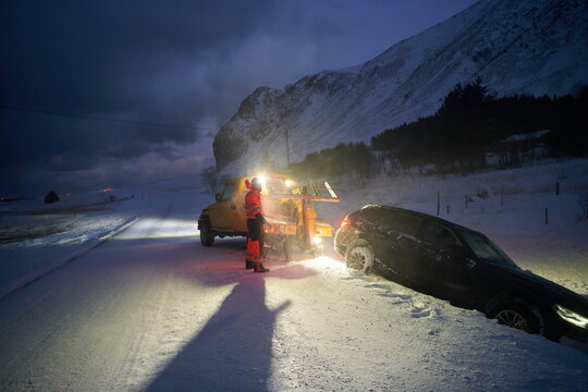 Car being towed after accident in snow storm