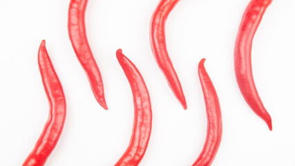 Red hot chili peppers on a white background. food figures. Vitamin vegetable food