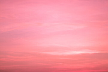 Beautiful twilight pink sunset sky in soft and smooth clouds with pastel color background