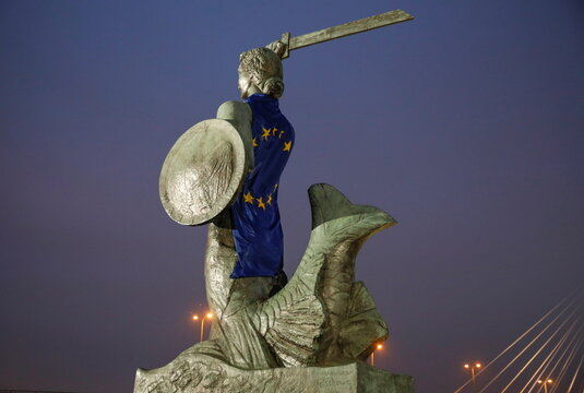 Mermaid of Warsaw statue is draped with the European Union's flag, in Warsaw