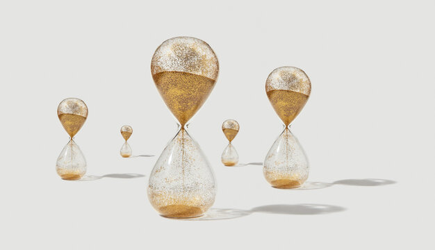 Hourglass with golden sand and shadows.