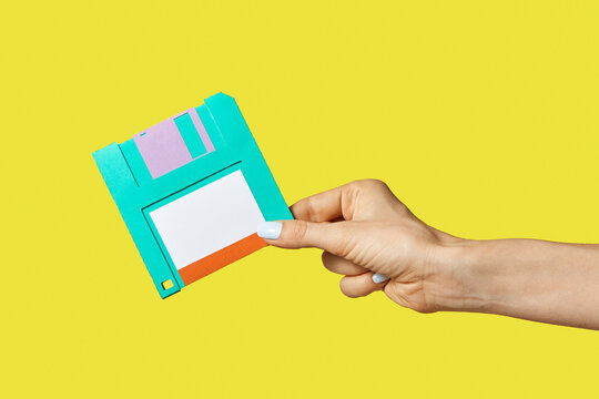 Paper craft diskette in the hand.